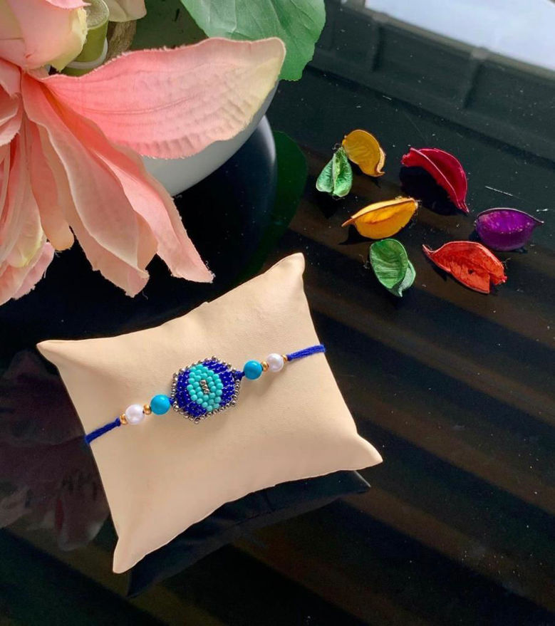Picture of Handmade Beaded Artwork Colourful Rakhi  with Mauli Thread for Brothers
